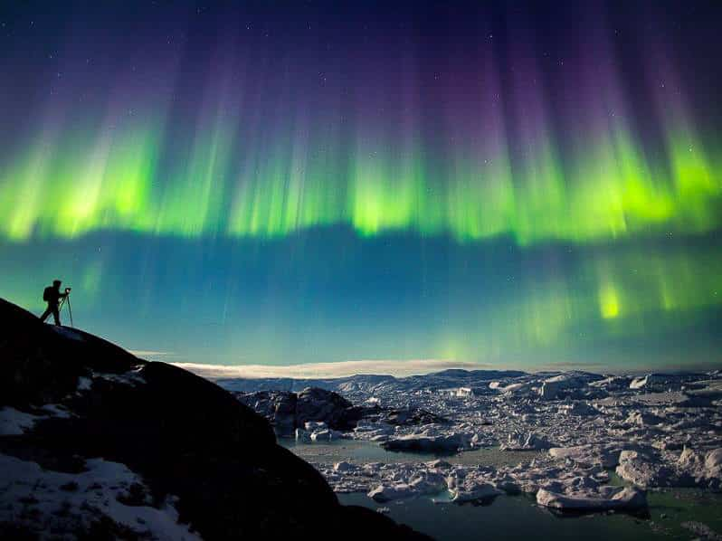 Northern Lights coloured green and purple over the Ilulissat Icefjord