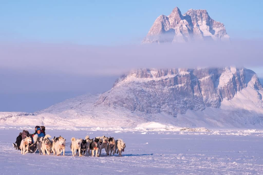 Dogsled tour across the sea ice near Uummannaq in North Greenland