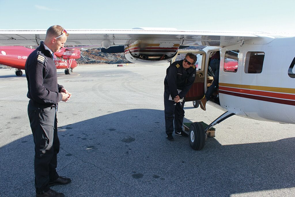 Pilots from Air Greenland preparing for take off