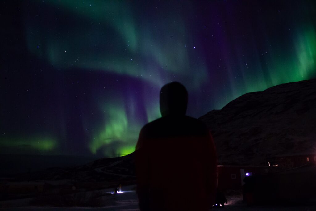 Man watching the northern lights