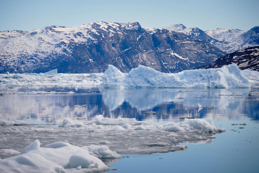 Reflections of icebergs in the water the Nuuk Icefjord on a boat tour - Guide to Greenland