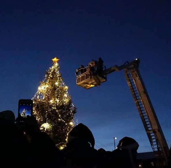 Christmas tree being lit up