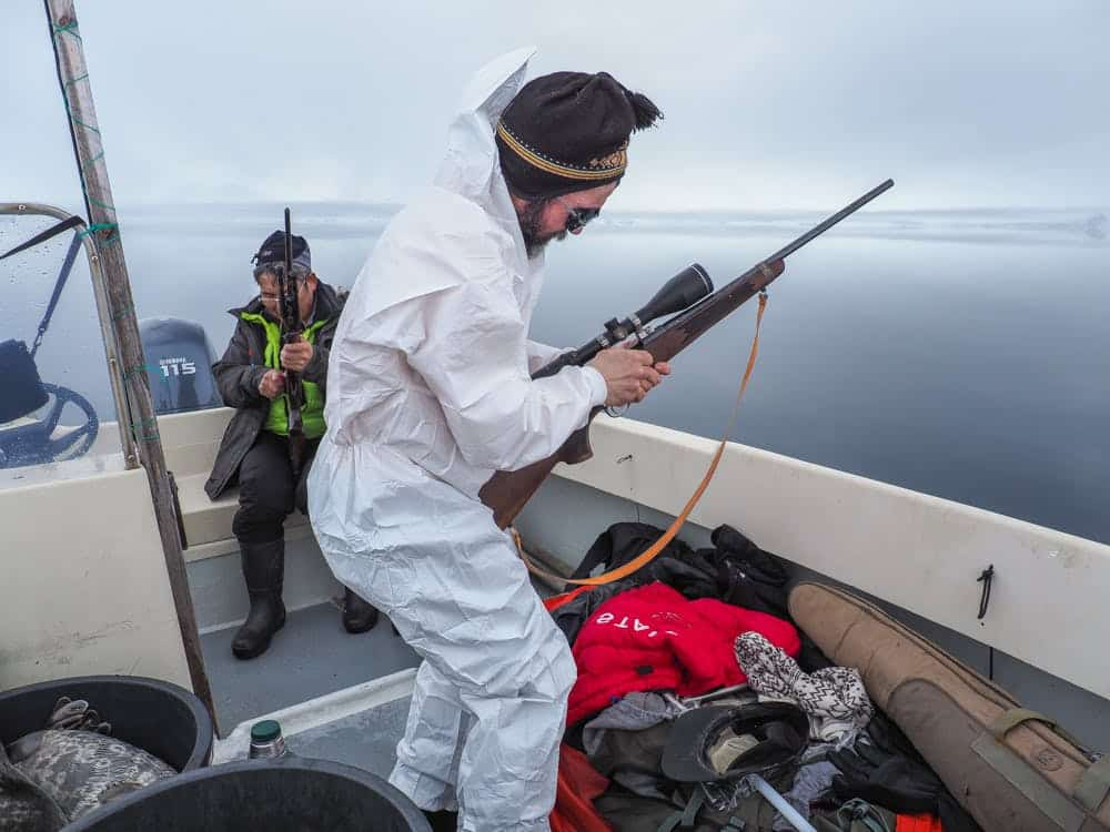 Seal hunter getting his riffle ready