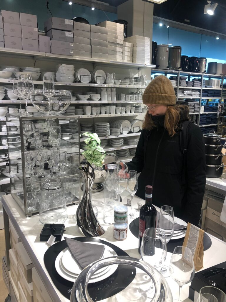 Woman looking at glasses in a store in Nuuk Center