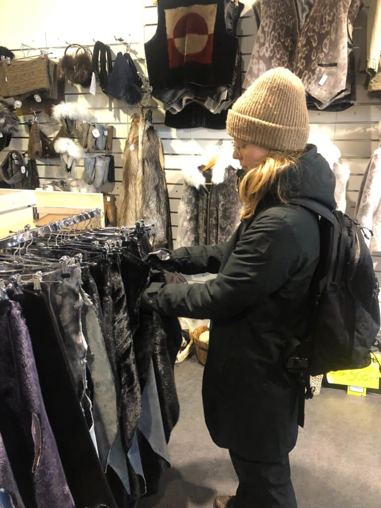 Woman looking at clothes in a store in  Nuuk Center