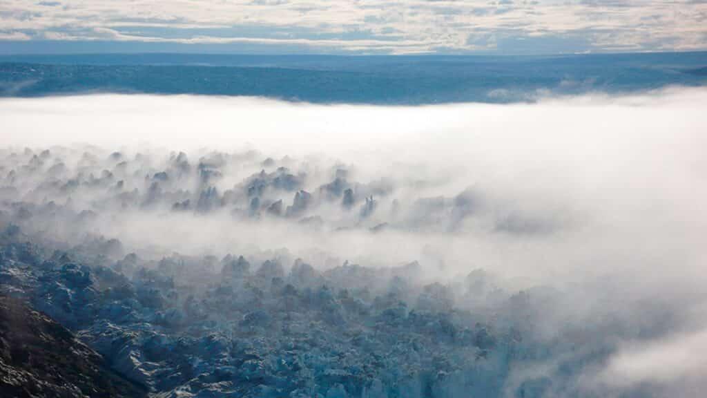 White fog over glacier in Greenland