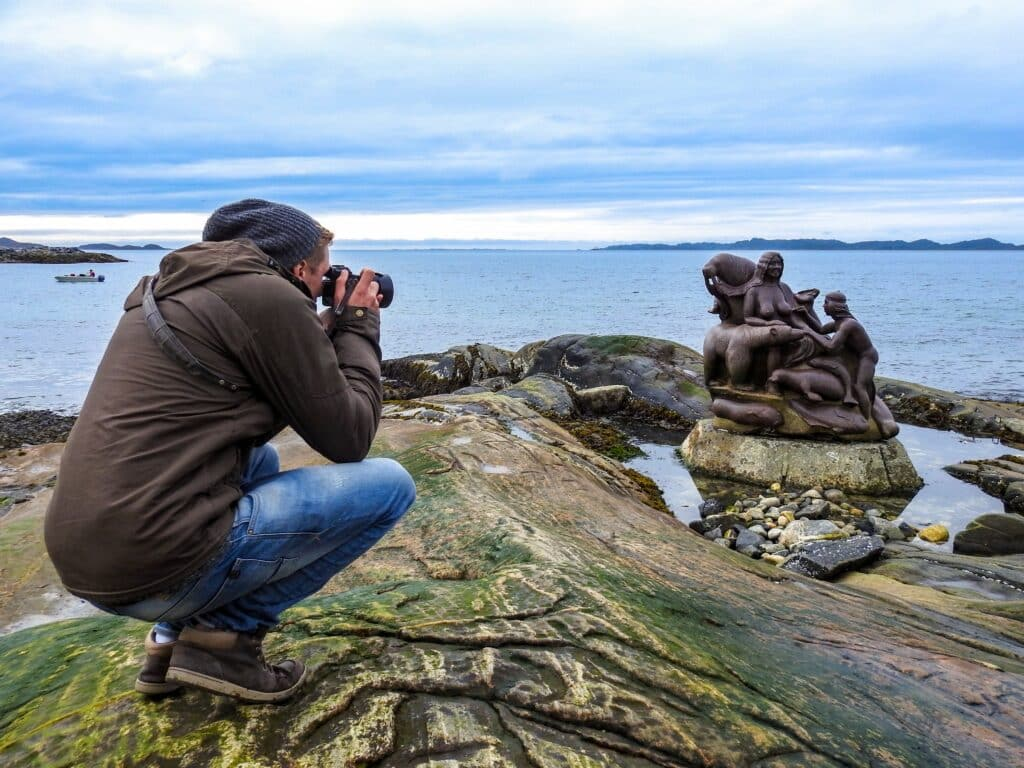 Man taking a picture of a statue in Nuuk