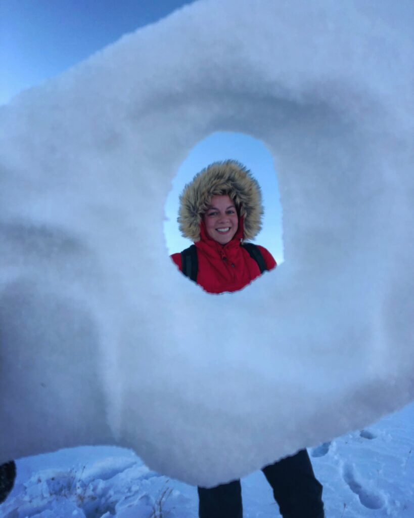 Woman seen through a hole in the ice