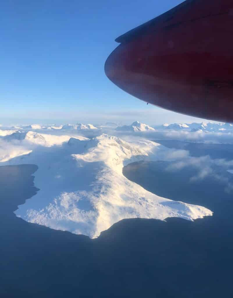 View of Greenland from above, land covered in snow