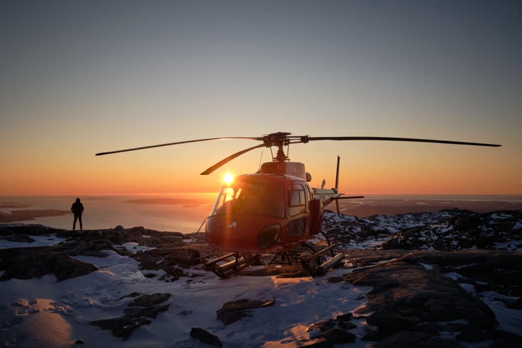 Twilight helicopter scenic flight with a summit landing on Sermitsiaq - Nuuk - Guide to Greenland