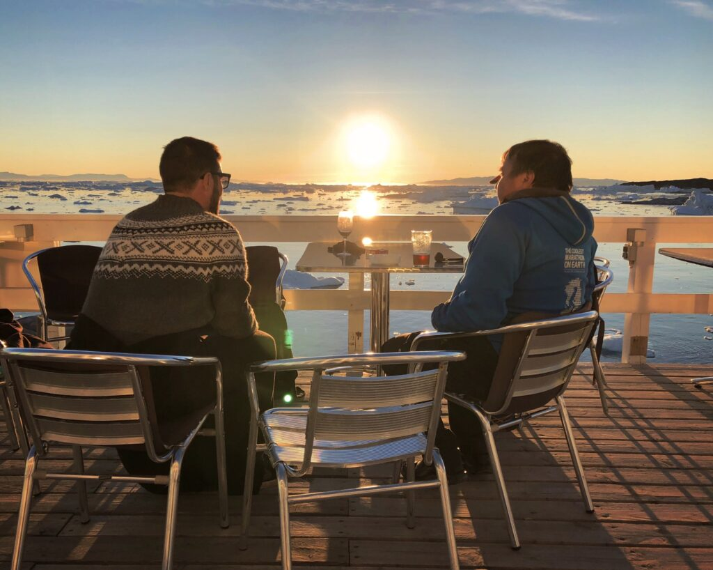 Couple enjoying the midnight sun in Ilulissat
