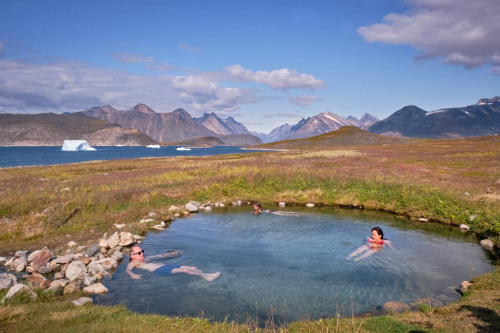 Couple enjoying a hot spring in South Greenland near Qaqortoq