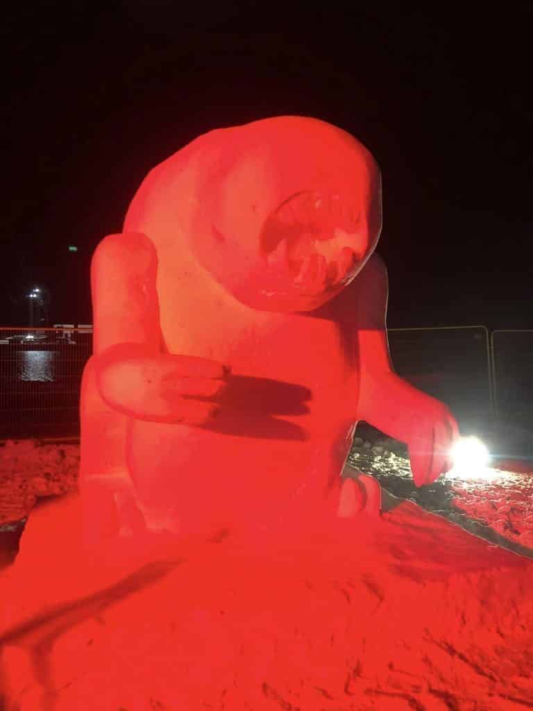 Snow sculpture lit in red