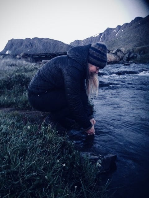 Woman dipping her hands in the water