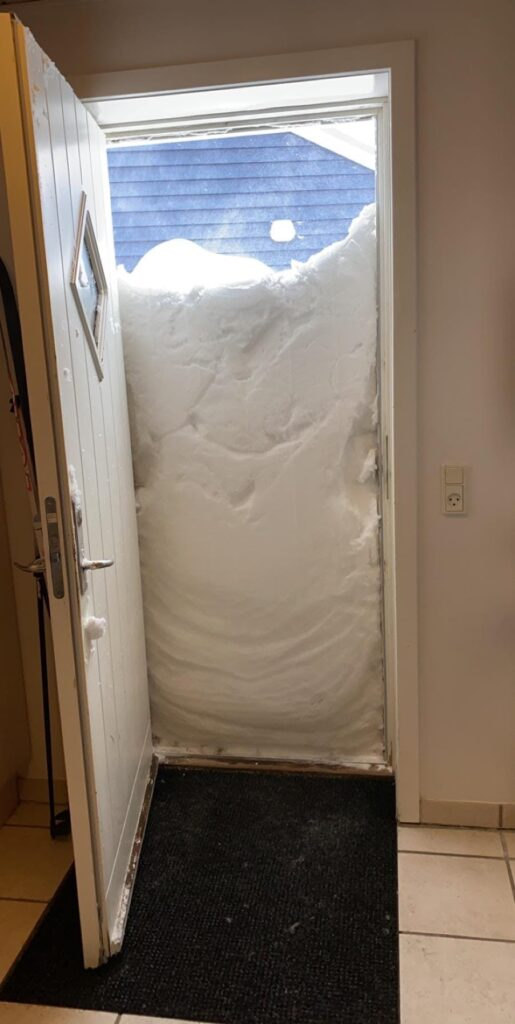 Snow blocking the door