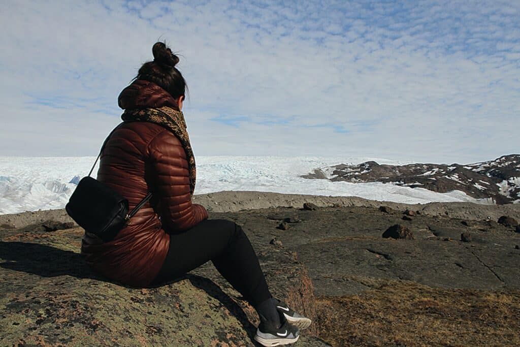 Woman looking at the ice sheet in Kangerlussuaq