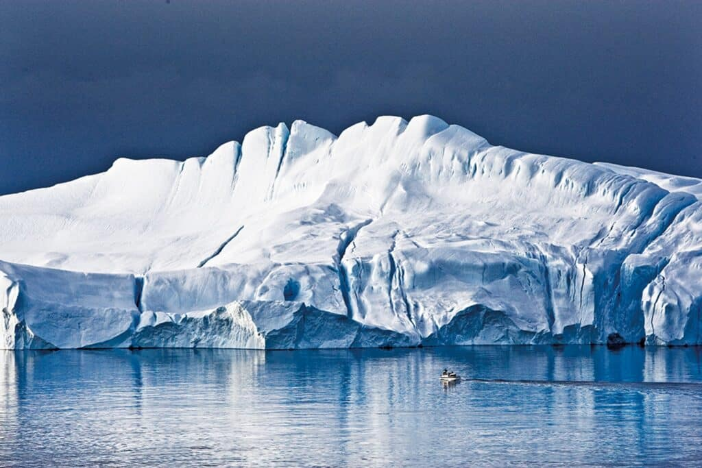 Iceberg and boat