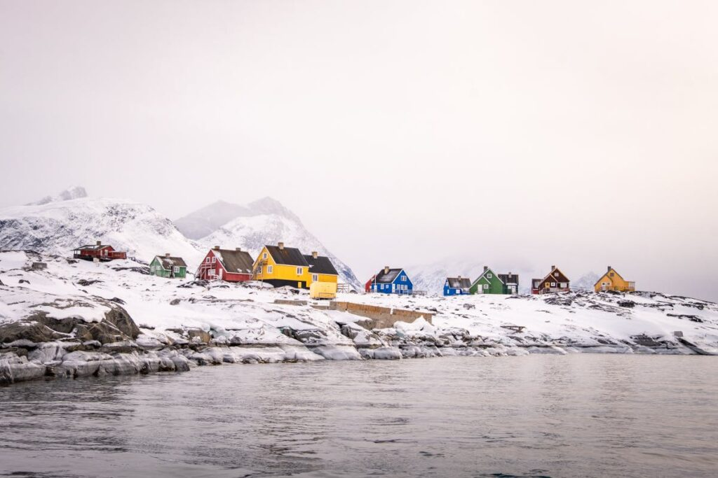 Colourful houses of qoornoq bright against the winter background - Guide to Greeenland