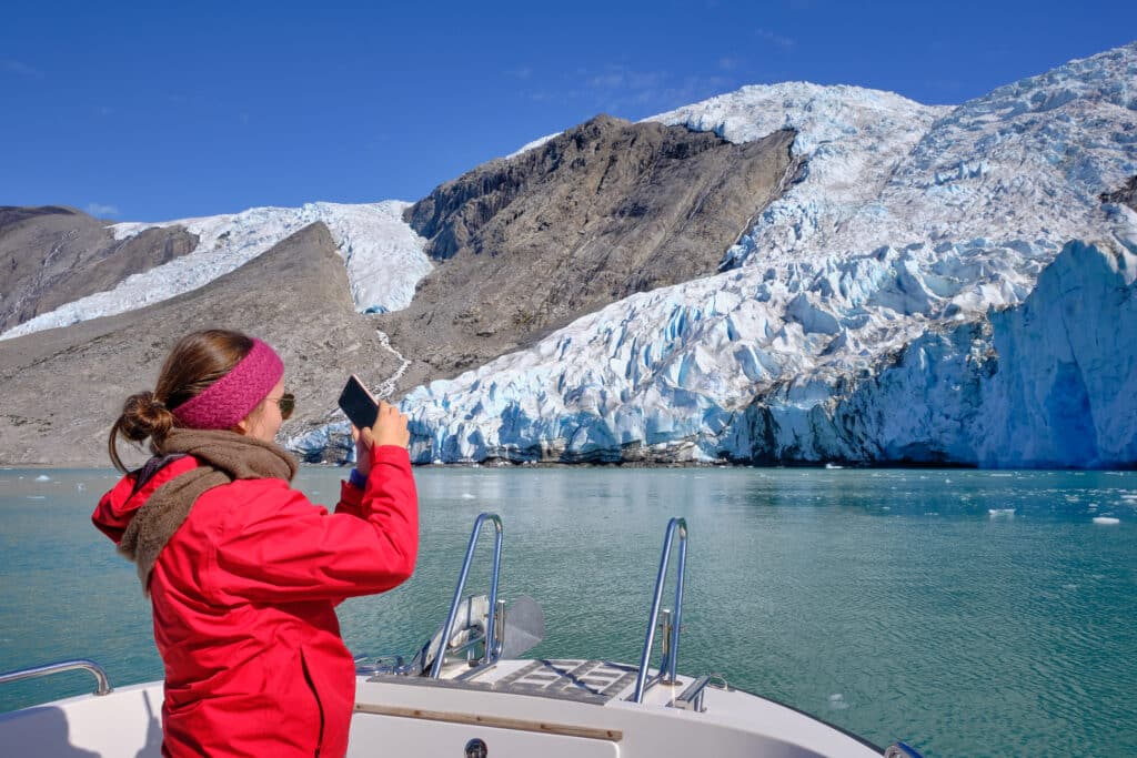 Taking photos at the end of the Eternity Fjord near Maniitsoq - Guide to Greenland