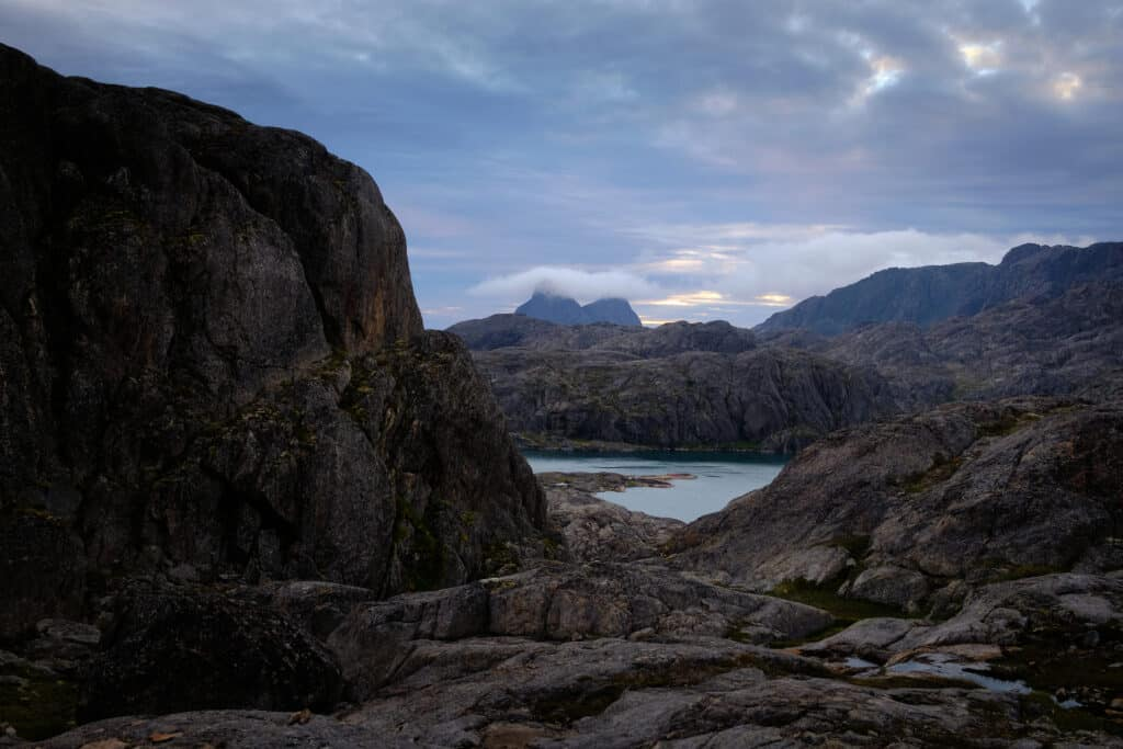 The twin peaks of Uummannarsuaq are hidden by clouds on a hiking trip near Maniitsoq - Guide to Greenland