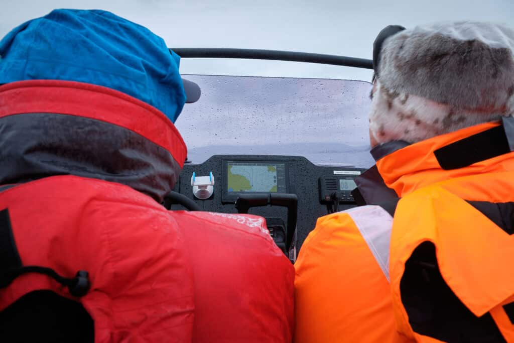 Bundled up in flotation suits on the way to Hvalsey Church - Qaqortoq