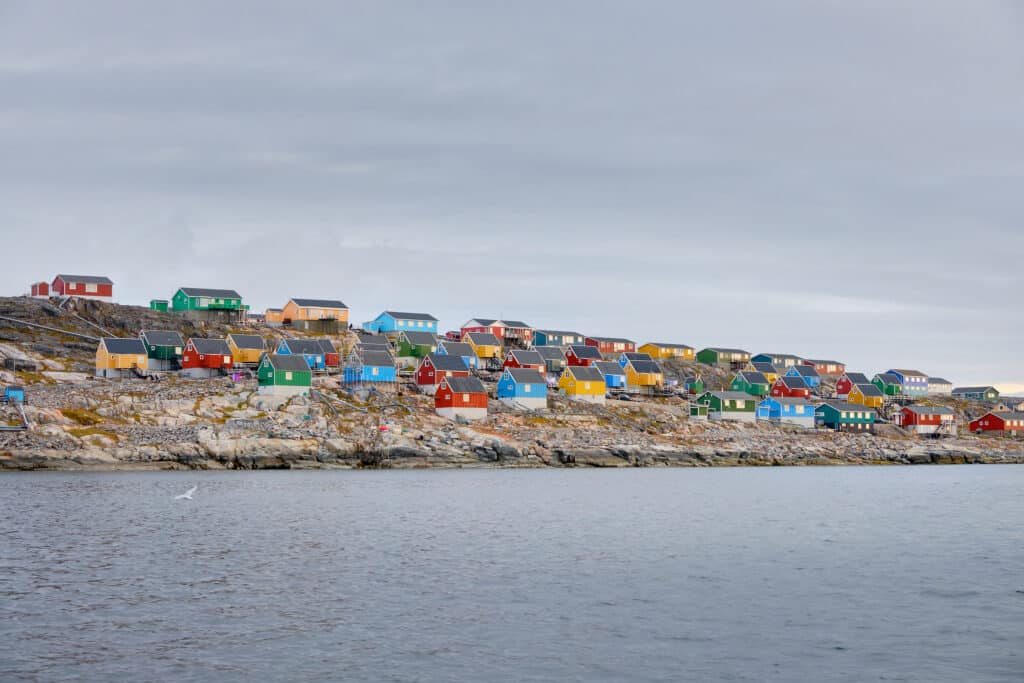 Colourful houses of Aasiaat lining Disko Bay