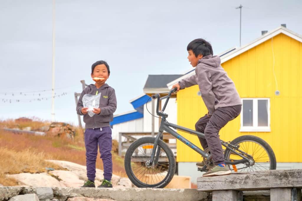 Kids on the dock at Akunnaaq near Aasiaat