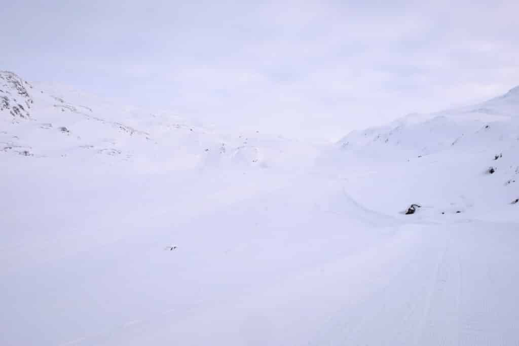 Snowmobile and dogsled route is difficult to see in the flat light near Sisimiut