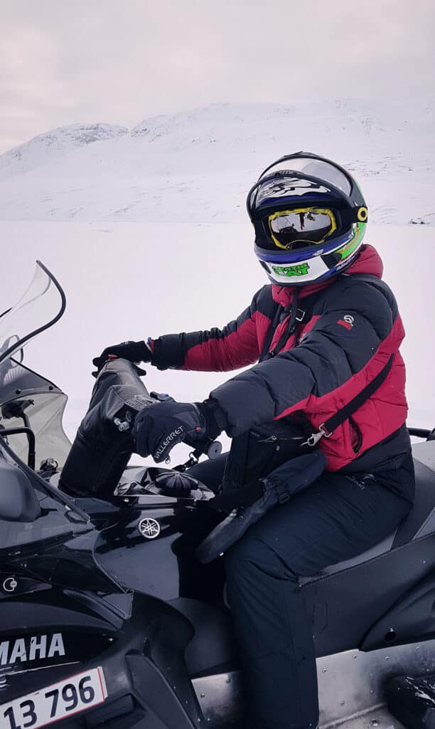 Snowmobile rider rugged up near Sisimiut