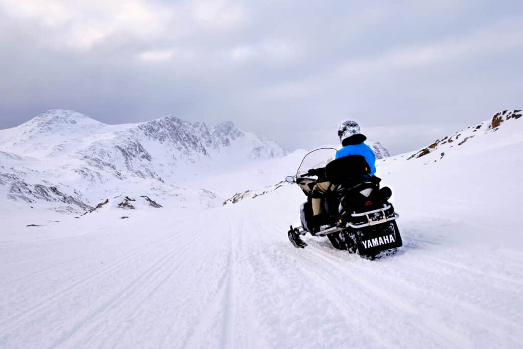 Snowmobiler looking down the route back to Sisimiut past nasaasaaq mountain