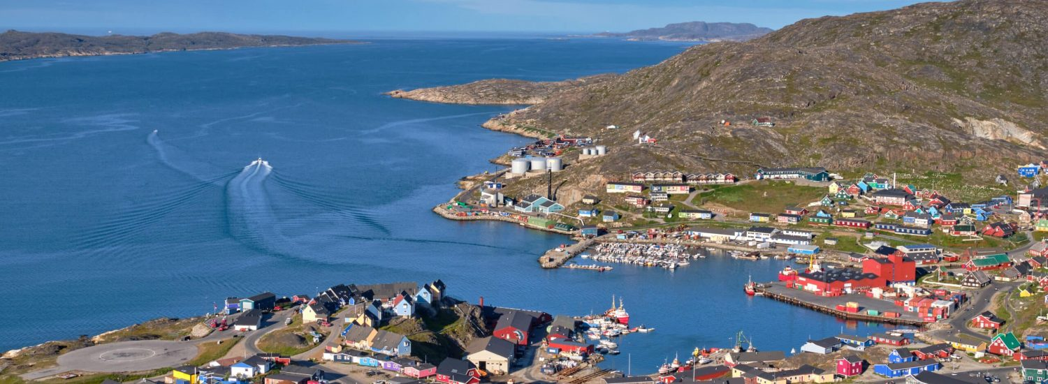 Aerial-view-of-Qaqortoq-from-a-high-mountain-viewpoint-summer-Guide-to-Greenland