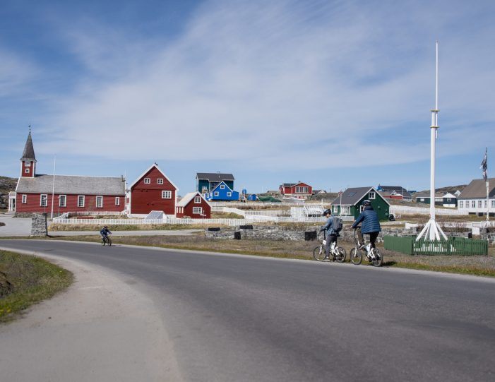 Bikers in old colonial harbour- cultural biking tour- Nuuk in summer- Guide to Greenland