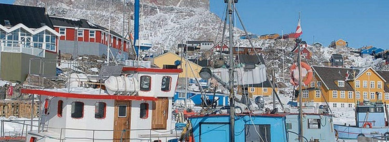Boat-stuck-in-sea-ice-in-Uummannaq-Greenland-by-Sabine-Barth