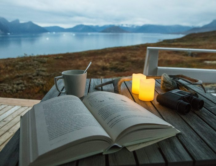 Calm evening with cup of tea and book on huts terrace- Nuuk fjord-guide to Greenland