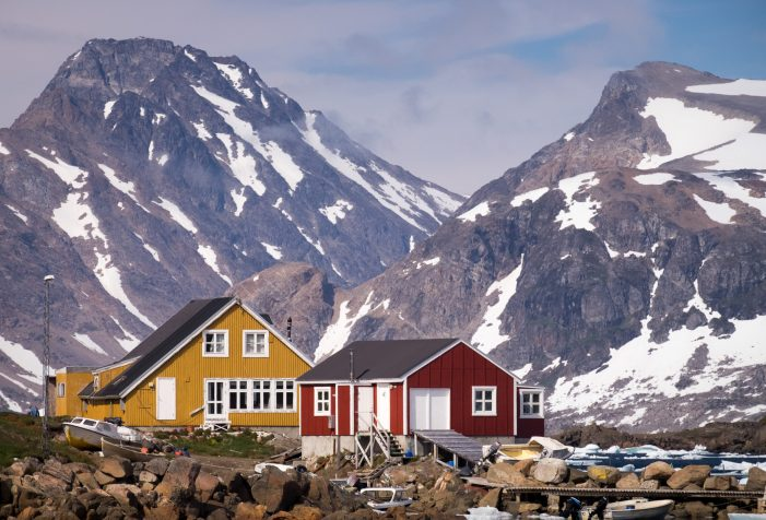 Colorful-houses-in-Kulusuk-set-against-the-impressive-mountains-of-East-Greenland-summer-Guide-to-Greenland