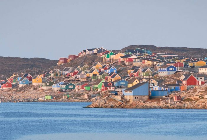 Colorful-houses-of-Aasiaat-line-up-along-Disko-Bay-summer-boat-tour-Guide-to-Greenland
