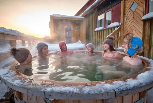 Friends enjoying a wilderness bath spa at the Arctic spa at the hotel sisimiut