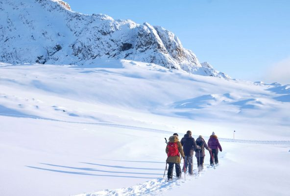 Heading out into the backcountry on a snowshoeing trip in Sisimiut - Guide to Greenland
