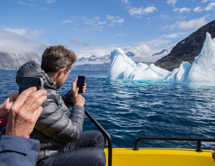 People taking pictures of the iceberg during boat trip- nuuk fjord- Guide to Greenland