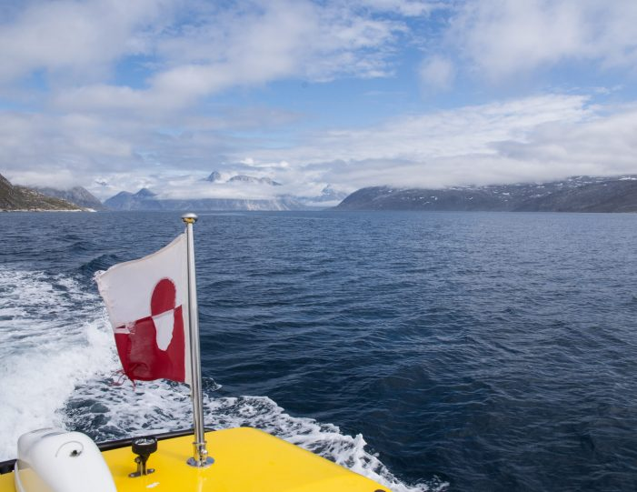 Sailing in Nuuk Fjord- flag on the boat- Guide to Greenland