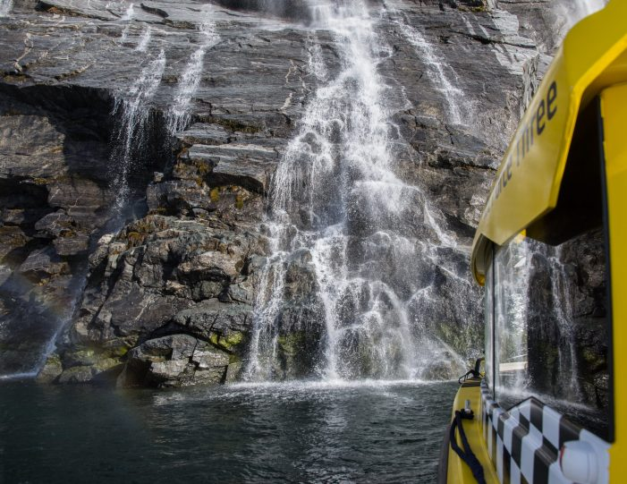Sermitsiaq waterfall and boat- nuuk fjord- Guide to Greenland