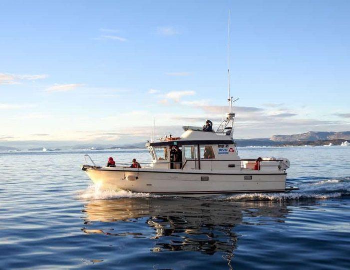 closed-boat-fjord-safari-nuuk- Guide to Greenland