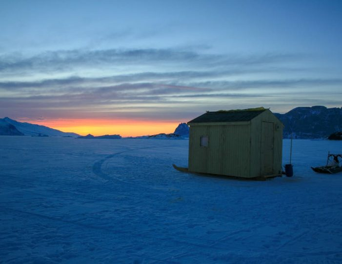 dogsled-expedition-hunting-and-fishing-on-sea-ice-uummannaq-north-greenland-Guide to Greenland9