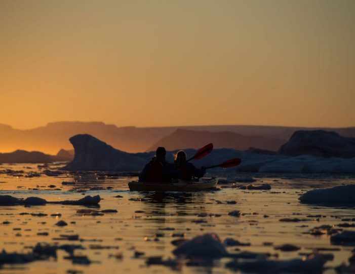 evening-kayaking-among-icebergs-ilulissat-disko-bay - Guide to Greenland5