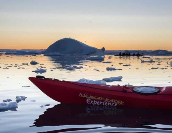 evening-kayaking-among-icebergs-ilulissat-disko-bay - Guide to Greenland7