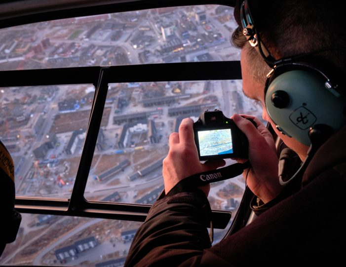 nuuk-scenic-helicopter-summit-flight-at-sunset-taking-pictures-of-the-city-of-nuuk-as-we-fly-over-summer-Guide-to-Greenland
