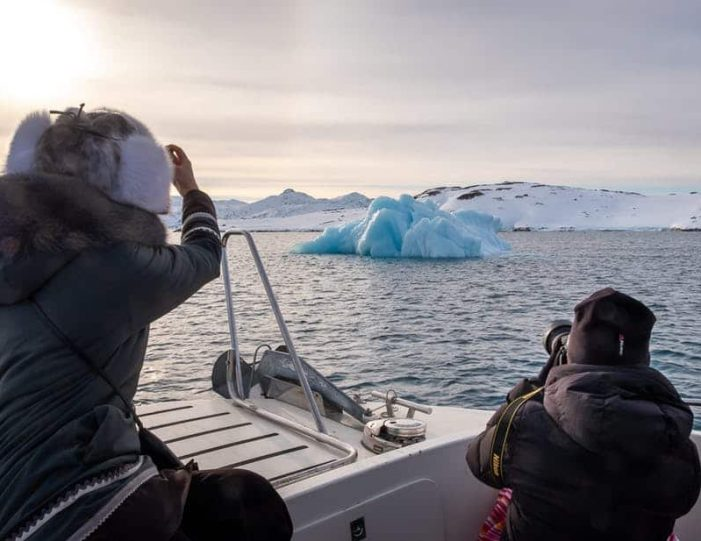 passengers-taking-photographs-of-an-iceberg-in-the-nuuk-fjord - Guide to Greenland