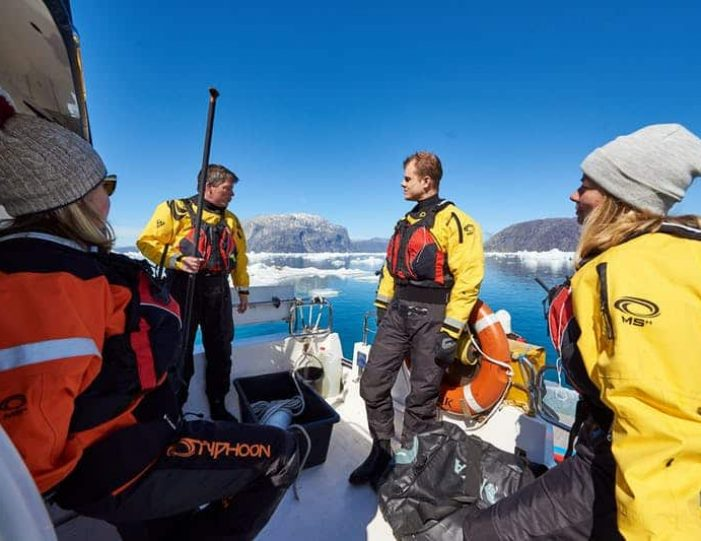 stand-up-paddleboarding-amongst-the-icebergs-nuuk-west-greenland - Guide to Greenland1
