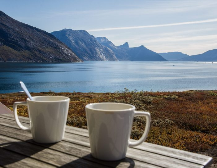 two cups with the view of the nuuk fjord- Guide to Greenland