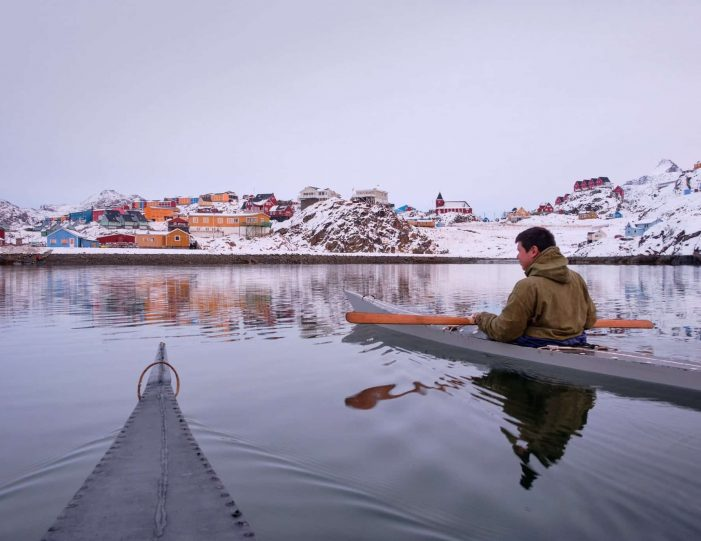 Kayaking in a traditional kayak in winter in Sisimiut - Guide to Greenland